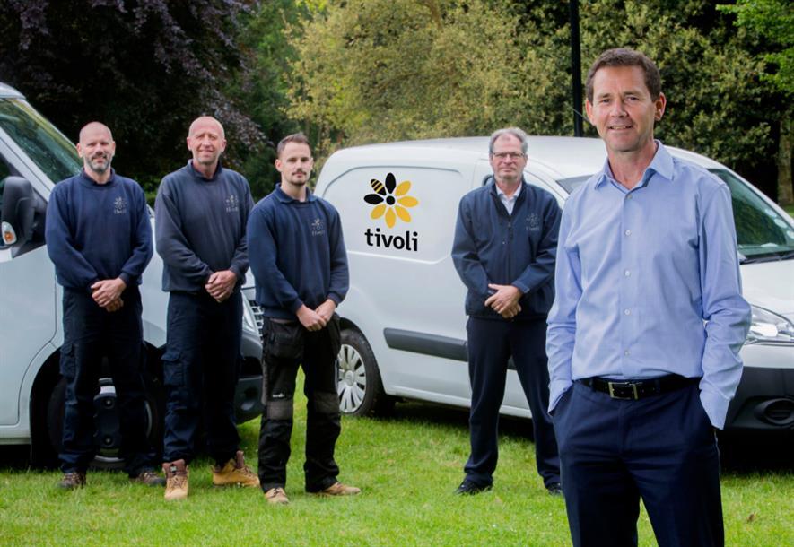 Phil Jones (right) with colleagues and the new Tivoli livery. Image: Tivoli