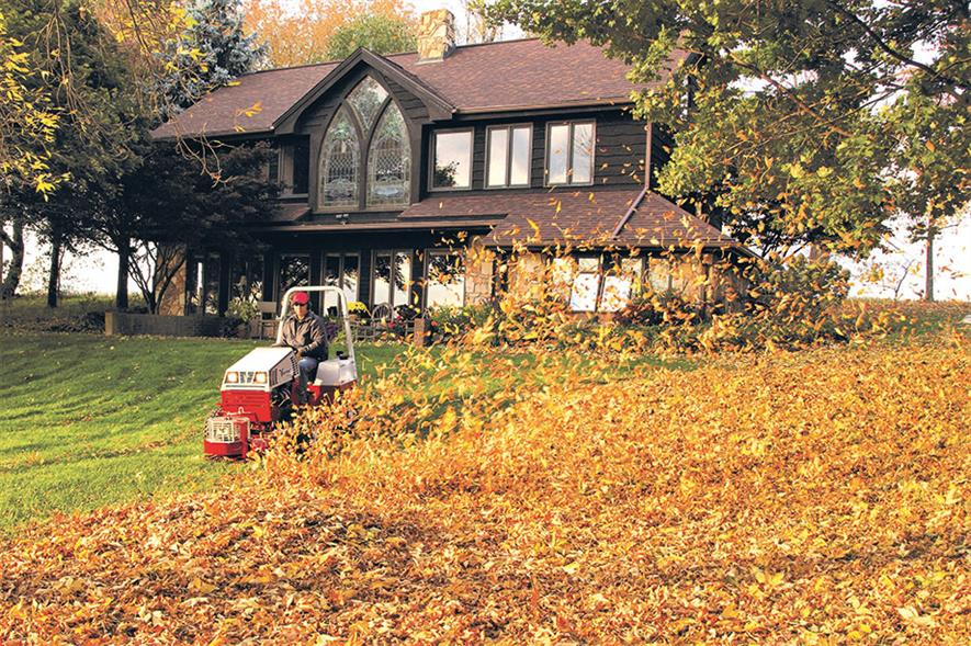 Leaf-clearance work: Ventrac 4500 compact tractor in use with blower attachment - image: Price Turfcare