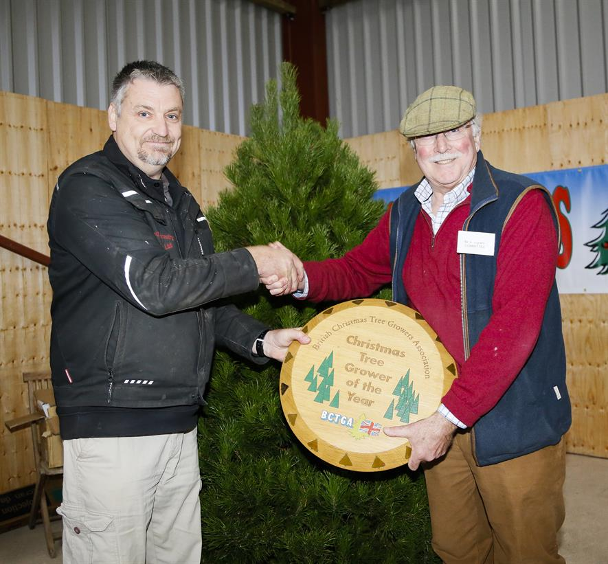 Dave Brown, BCTGA committee member (Festive Forestry), presents Andrew Ingram with the Champion Tree Grower award