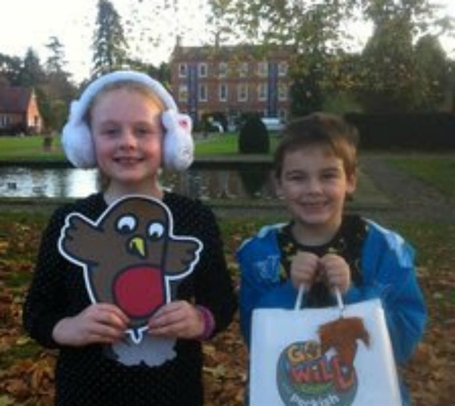 Jasmine (aged 8) and Jaiden (aged 7) with their Go Wild With Peckish goodies after completing the activities at Burford House Garden Store in Worcestershire.