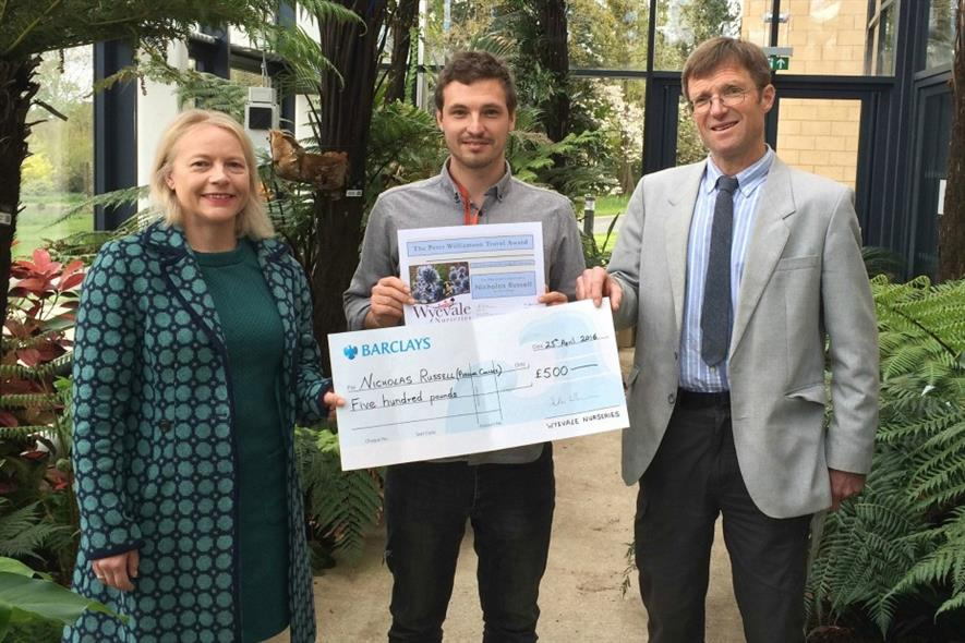 Heather Williamson, Joint Chairman of Wyevale Nurseries, and (right) Steve Ashworth, Director at Wyevale Nurseries, present Nicholas Russell from Pershore College with the Peter Williamson Travel Award.