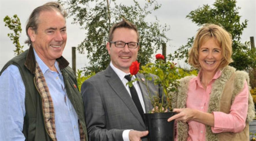 Dr Stephen Clarke, Head of Remembrance at The Royal British Legion, is pictured with Frances and Julian de Bosdari, owners of Ashridge Nurseries in Castle Cary, Somerset.