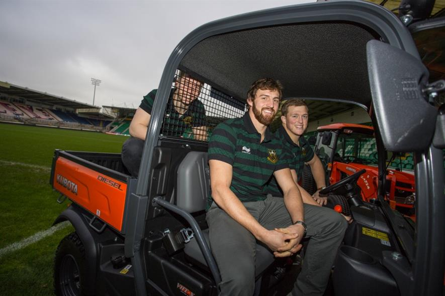 Northampton Saints players in a new Kubota machine. Image: Kubota UK