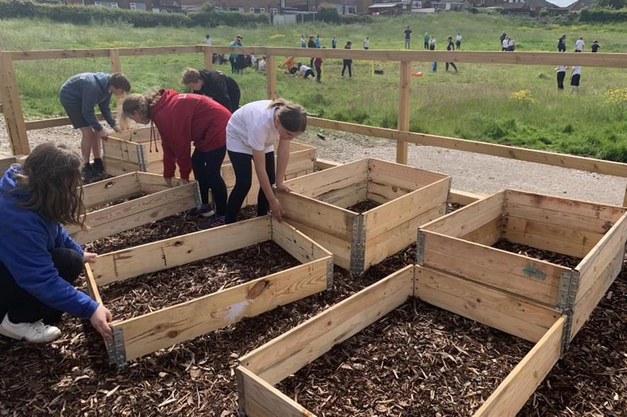 Students putting out raised beds - credit: Green-tech