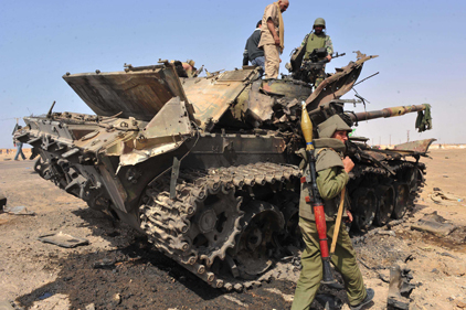 Offensive: Pro-Gaddafi forces recapture the town of Ajdabiya [pic Rex Features]