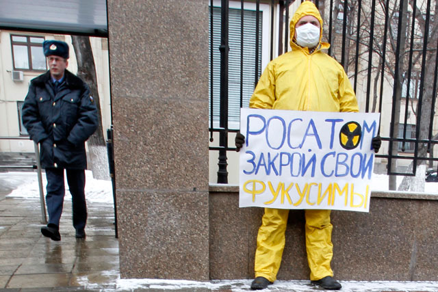 Controversy: an activist outside Rosatom's base in Moscow (PA Photos)