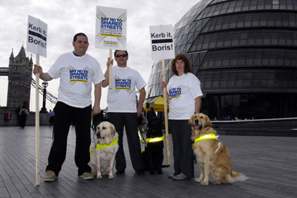 Guide Dogs for the Blind: Protestors outside City hall