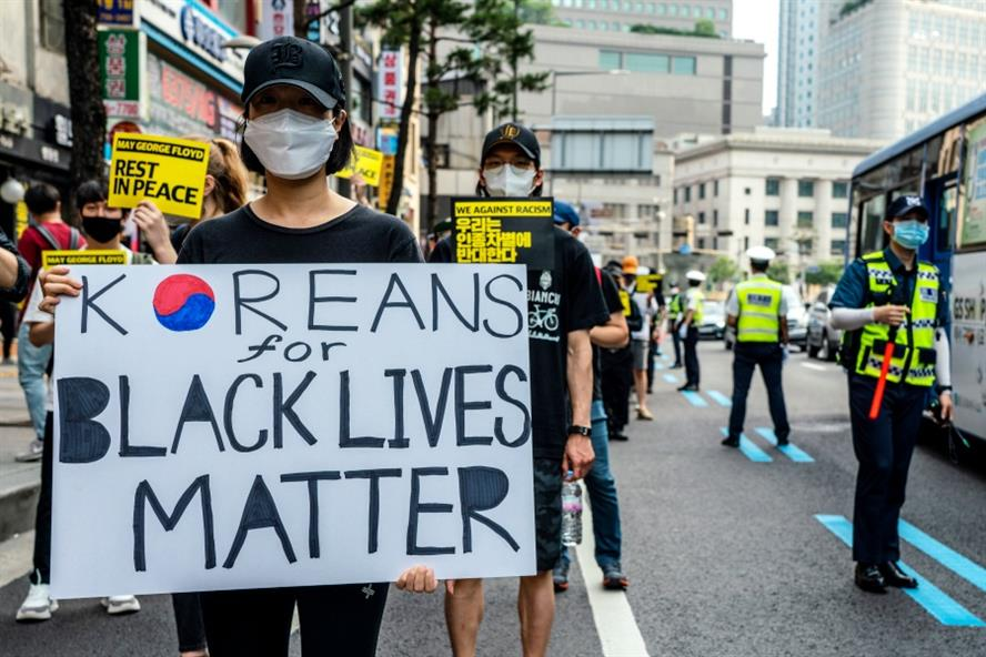 Thousands in Seoul march on the streets in support of the #BlackLivesMatter movement. Source: Getty Images