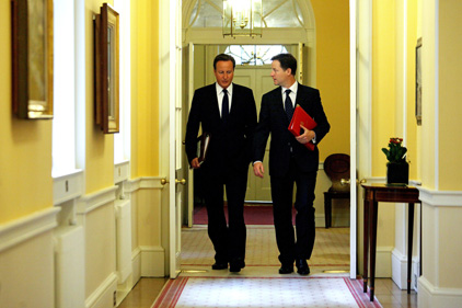 Partners: But is Nick Clegg seeking distance from David Cameron? [Pic Getty Images]