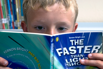 Absorbing read: a young boy is engrossed in a book