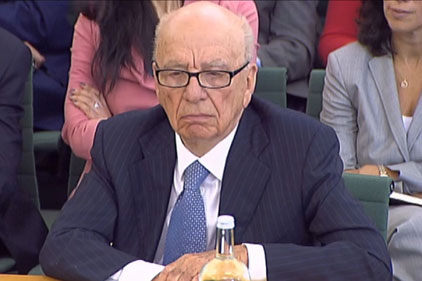 Rupert Murdoch: apologises in newspapers for hacking