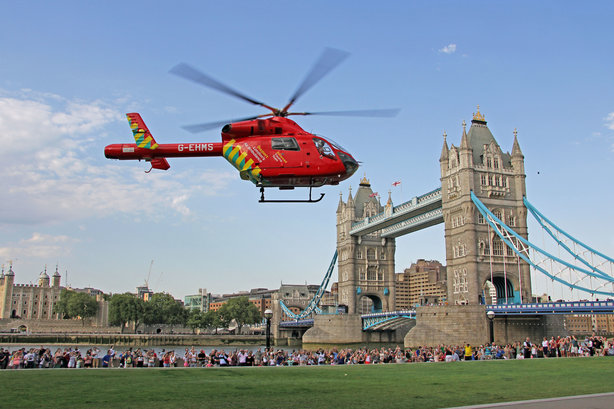 London's Air Ambulance in action over Tower Bridge. Two thirds of people do not know it is a charity