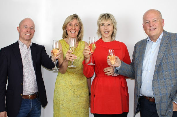 L-R Jim Selman, MD UK and Ireland for A+P celebrates the OneChocolate acquisition with Sue Grant, Jill Coomber, and Scott Allison