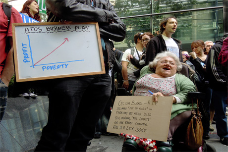 On the attack: Disability campaigners outside Atos' London headquarters