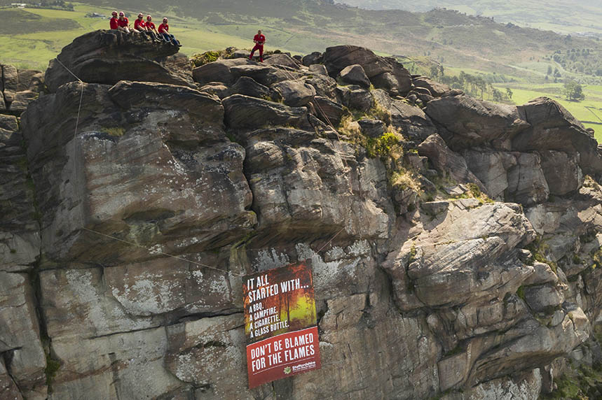 Buxton Mountain Rescue scales the Roaches to suspend a banner for the SFRS campaign
