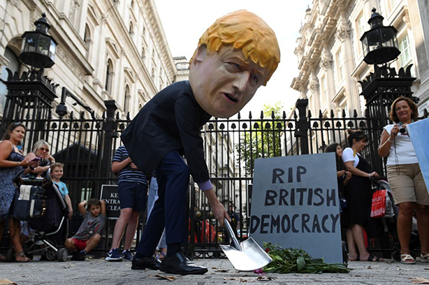 Protestors make their views about Boris Johnson clear at a Stop the Coup rally yesterday. (Photo: Daniel Leal-Olivas/Getty Images)