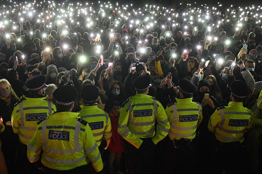 Police form a containment line at a vigil for Sarah Everard at Clapham Common on Saturday night (Photo: Getty Images)