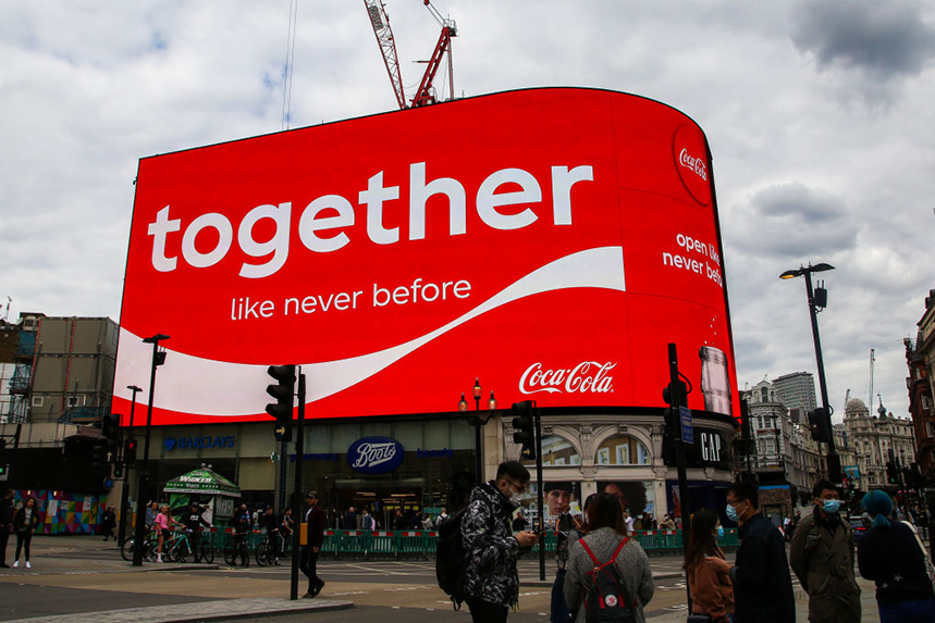 A recent Coca-Cola advertisement at Piccadilly Circus in central London (Photo: Getty Images)