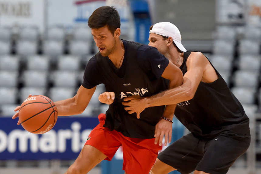 Novak Djokovic and Grigor Dimitrov playing basketball at the Adria tournament. Both contracted COVID-19. Photo: Getty Images.
