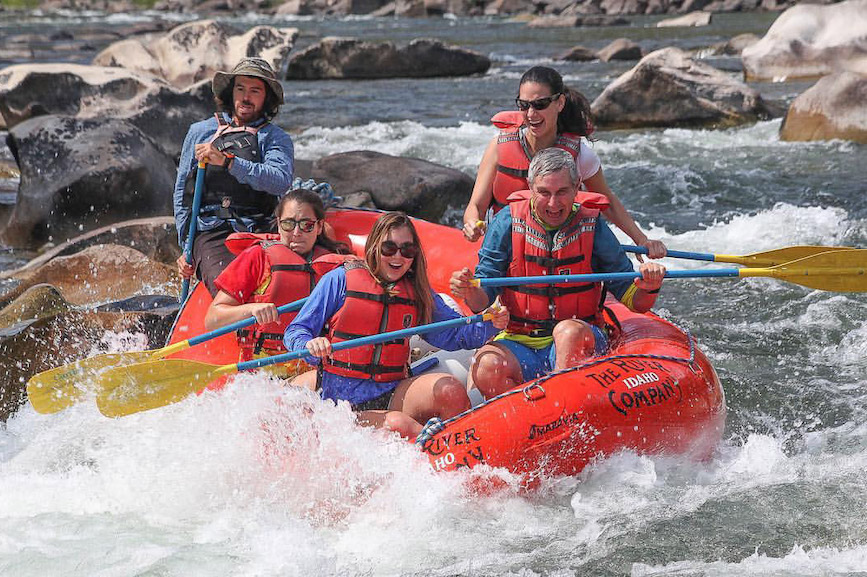 Richard Edelman and his three daughters ride the rapids.