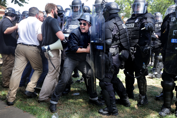 Neo-Nazis push back on police during a far-right rally in Charlottesville [Pics: Getty Images]