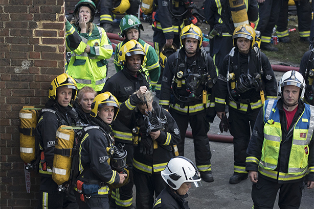 Firefighters look up at the Grenfell Tower, some of the 200 who attended the scene of the fire (pic credit: Peter MacDiarmid/REX/Shutterstock)