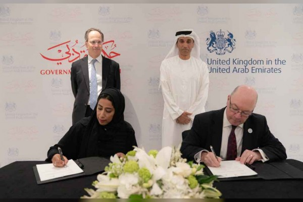 Mona Al Marri, director general of the Government of Dubai Media Office, Alistair Burt MP, Minister of State for the Middle East sign the MoU (pic credit:Government of Dubai)