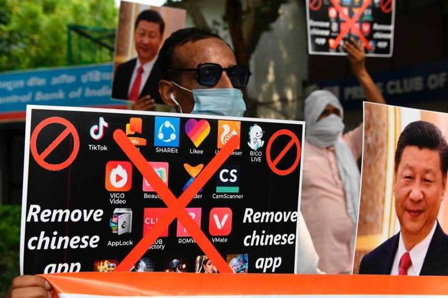 Members of the Working Journalist of India (WJI) hold placards urging citizens to remove Chinese apps during a demonstration against the Chinese newspaper Global Times, in New Delhi on June 30, 2020. Source: Getty Images