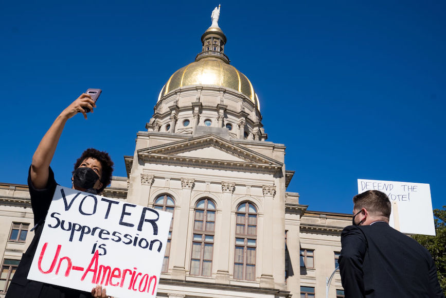 Demonstrators stand outside of the Capitol building in opposition to House Bill 531 on March 8, 2021 in Atlanta, Georgia. (Credit: Getty Images)