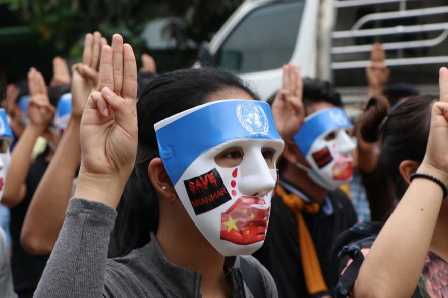 People, with their masks, stage a demonstration to protest against the military coup in Yangon on April 4 (Getty Images)