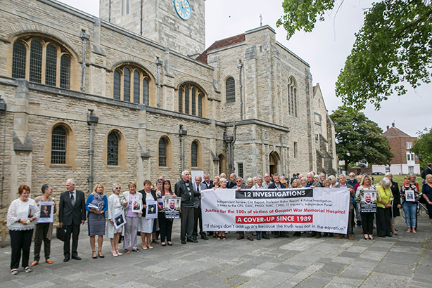 Relatives of people affected by the scandal hold banners ahead of the inquiry's report (Pic credit: Brighton Pictures/REX/Shutterstock)