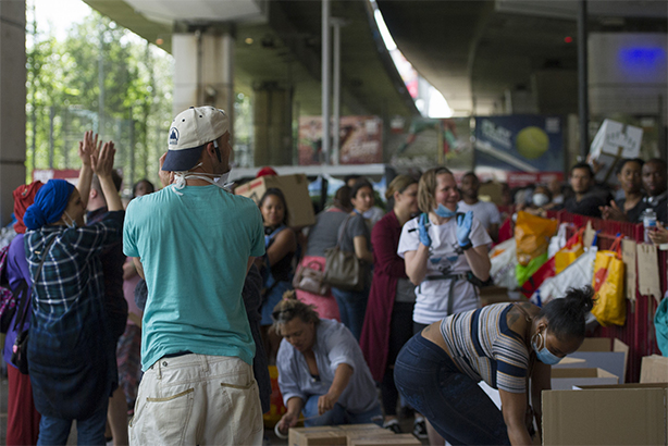 Volunteers organise donations under a flyover at Latimer Road, the morning after the fire at Grenfell Tower (pic credit: David Mirzoeff/PA Wire/PA Images)