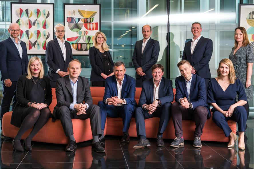 Hanover's executive committee with CEO Charles Lewington (front row, third from left) and Avenir Global's Ralph Sutton (front row, third from right). Pic credit: Paolo Ferla