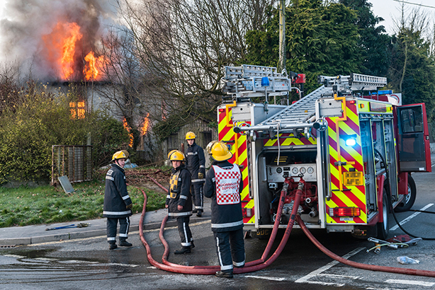 Firefighters tackle a house fire (Pic credit: Alex Ramsay / Alamy Stock Photo)