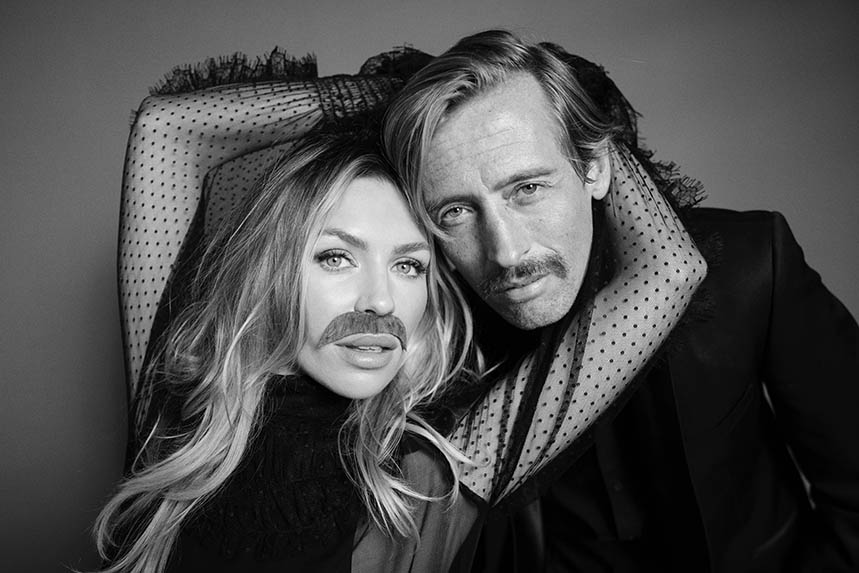 Abbey Clancy with husband Peter Crouch, in one of the celebrity portraits by Greg Williams for this year's Movember campaign
