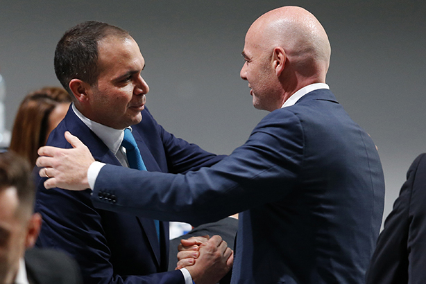 Prince Ali (left) congratulates new FIFA president Infantino (Credit: Michael Probst/AP/Press Association Images)
