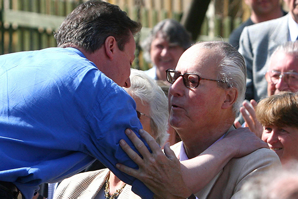 Embracing tax evasion? Cameron and his father (Credit: Johnny Green/PA Wire/Press Association Images)