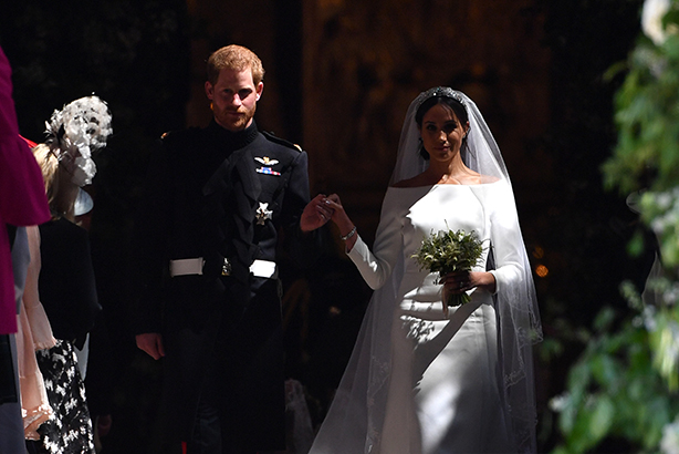 The new Duke and Duchess of Sussex emerge from the West Door of St George's Chapel, Windsor Castle (Credit: AFP Photo/Pool AND AFP Photo/Ben Stansall)