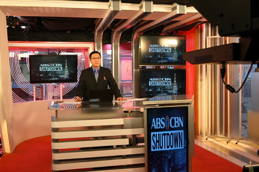 Ron Cruz, anchor of ANC, a subsidiary of ABS-CBN, is seen during an afternoon newscast at its studio in Manila on May 5
