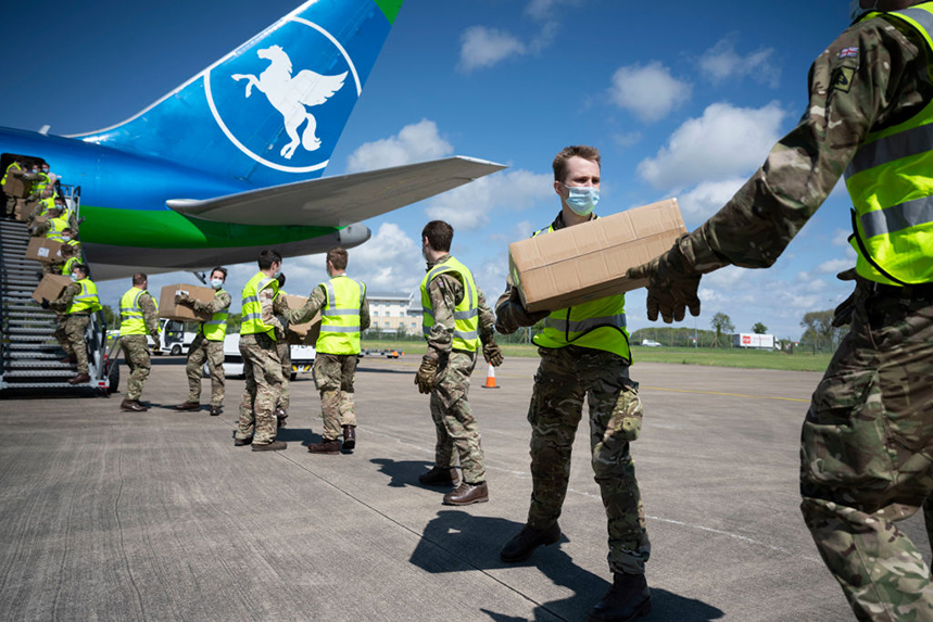 A shipment of PPE is unloaded by the military at Cardiff Airport. The Government's distribution of medical supplies has 'fallen short', survey respondents say (Photos by Matthew Horwood/Getty Images)