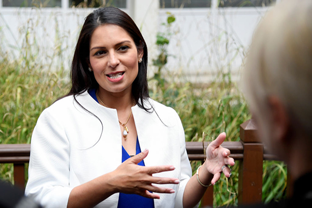 Priti Patel believes the police shouldn't 'waste' resources on social media comms salaries. (Photo: Toby Melville/Getty Images)