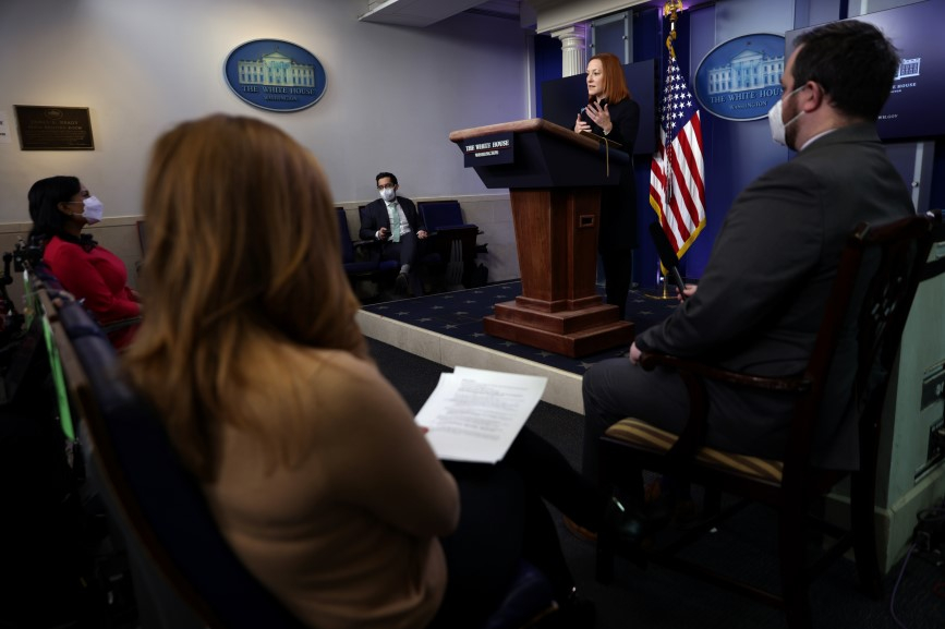 Deputy press secretary TJ Ducklo looks on as Jen Psaki delivers the daily White House press briefing on Thursday. (Pic: Getty Images.)