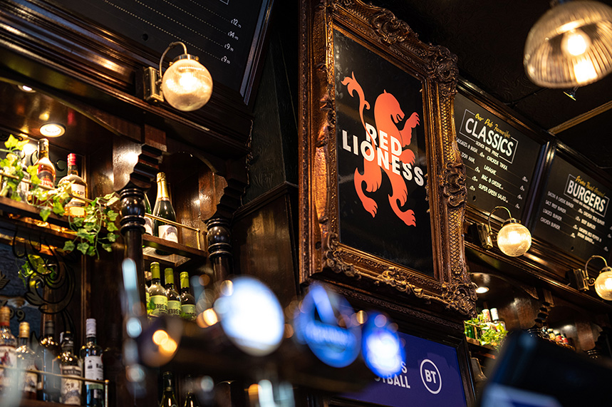 BT: pub decorated with women's sporting memorabilia
