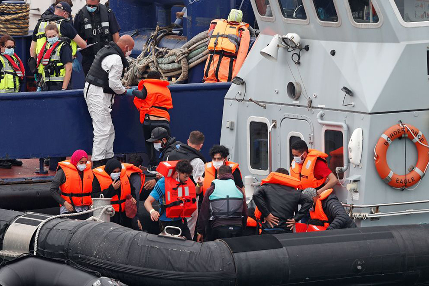 UK Border Force officials help migrants intercepted while travelling from France to Dover (Photo: Getty Images)