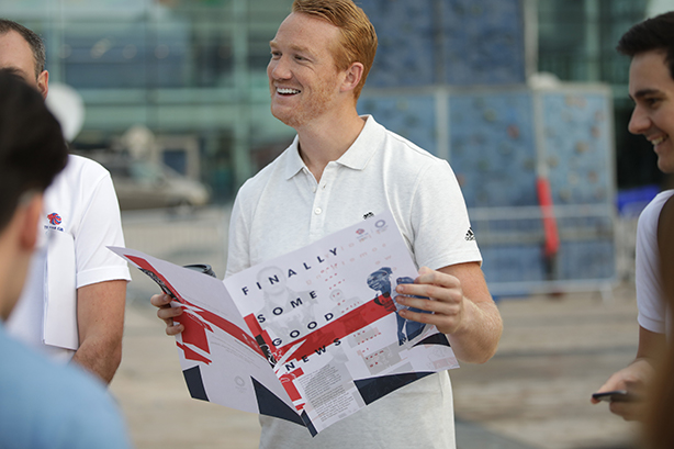 Olympian Greg Rutherford braved the heatwave in Manchester to hand out Team GB papers.