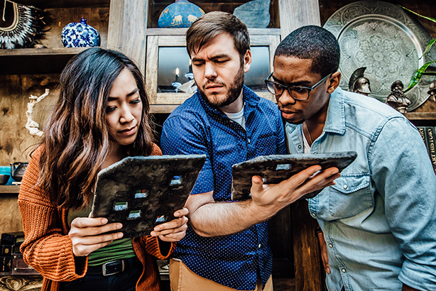 Players at The Escape Game try to unlock clues in a heist-themed adventure. (Photo courtesy of The Escape Game)