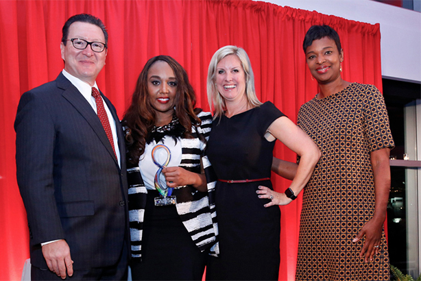 On behalf of Edelman, Smith (2nd l) and U.S. COO Julianna Richter (3rd l) receive 2016 Diversity Distinction in PR Award from judges Paul Capelli (l) and Tonya Veasey (r)