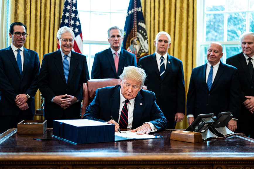 President Trump signs business relief into law last Friday. (Photo credit: Getty Images)
