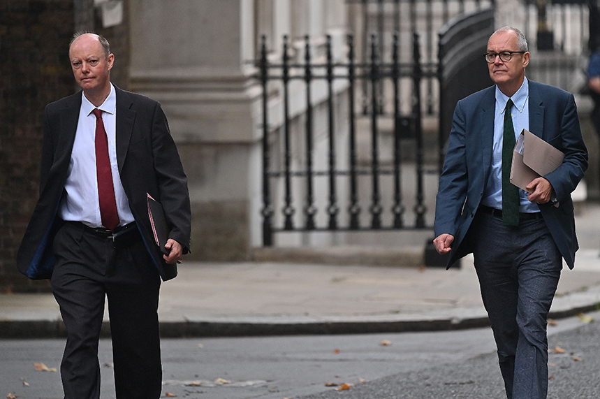 Grim faces as Professor Chris Whitty (L) and Sir Patrick Vallance (R) arrive at Downing Street yesterday to deliver a sobering briefing (Pic: Getty)