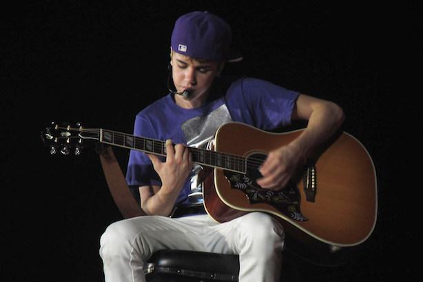 "Justin Bieber performing in 2011. (""Justin Bieber Hallenstadion Zurich Switzerland"" by Pascal Parvex. Image via Wikimedia Commons)."
